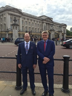 Image 1: Alex and Dixon in their best suits outside Buckingham Palace.